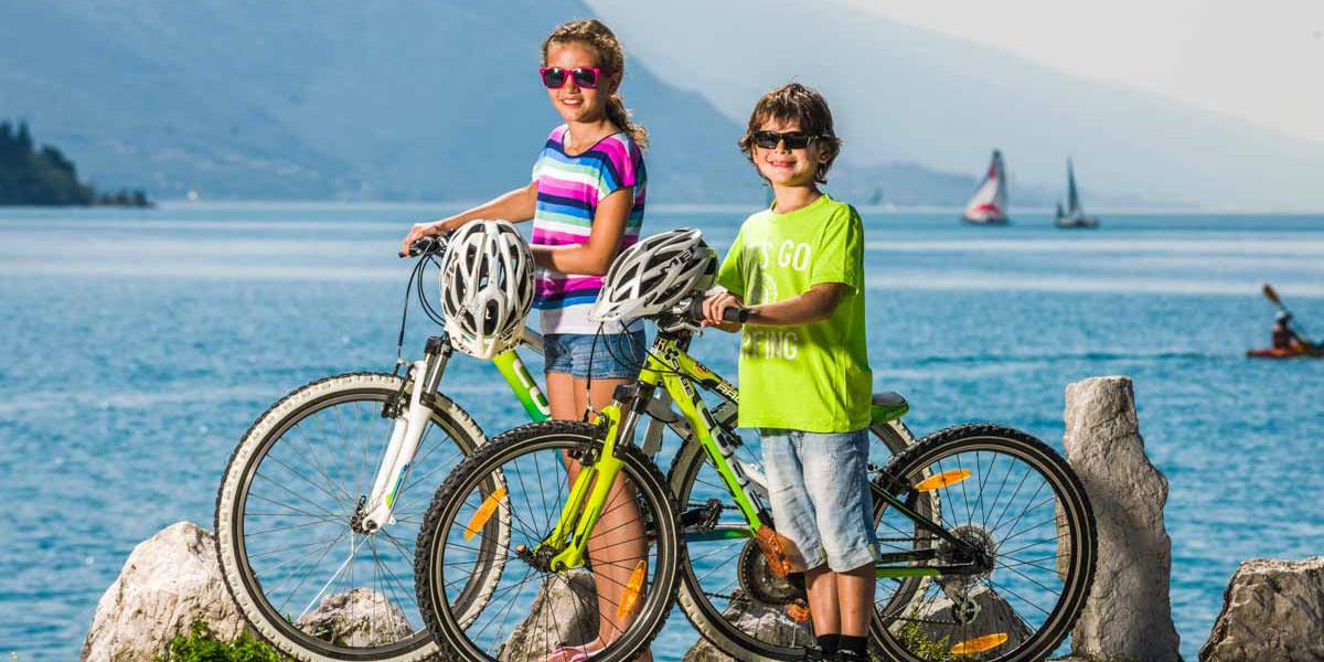 Family cycling in Lake Garda
