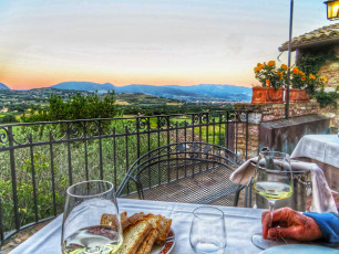 Umbria hotel terrace with wine and sunset
